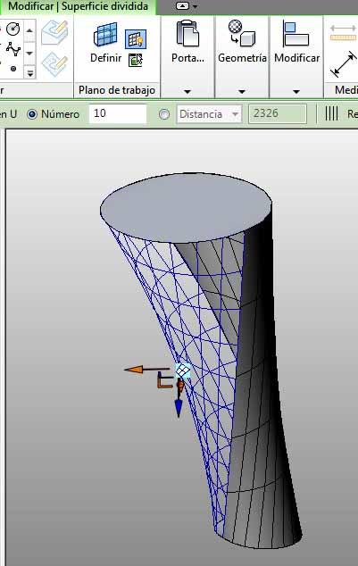 Aplicación a la forma, a una mitad la rejilla UV (malla color azul) y a la otra mitad, un patrón rectangular